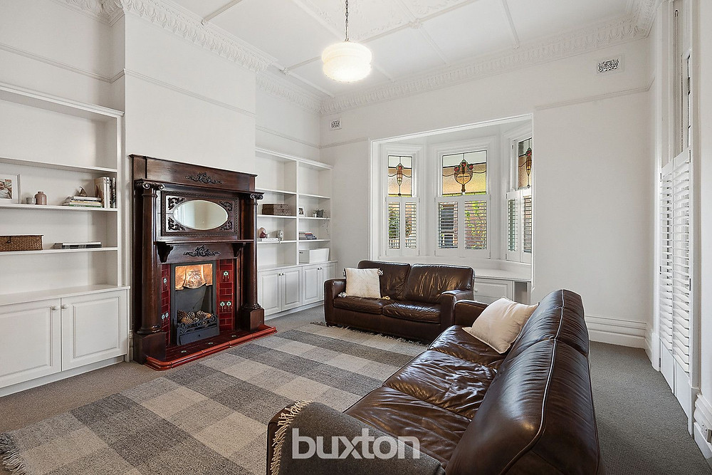 The detailed ceilings in the loungeroom draw the eye up at 236 La Trobe Tce, Geelong West