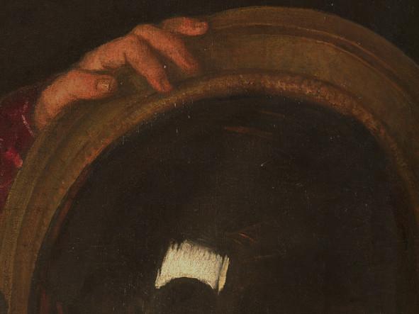 particolare del quadro di Tiziano, lo specchio convesso dietro la donna
