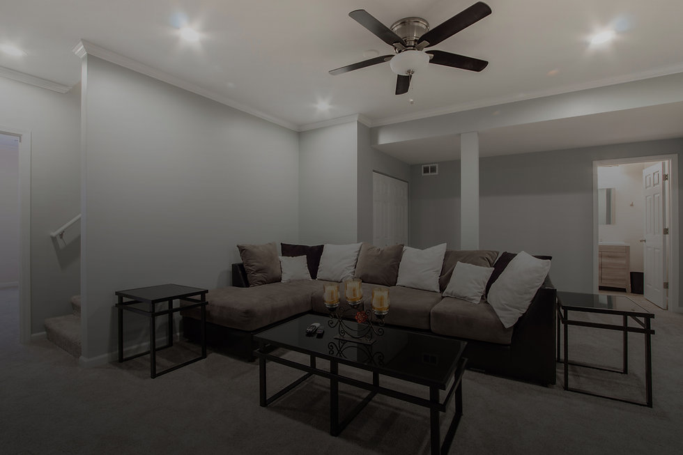 homey-basement-with-couch-and-coffee-table