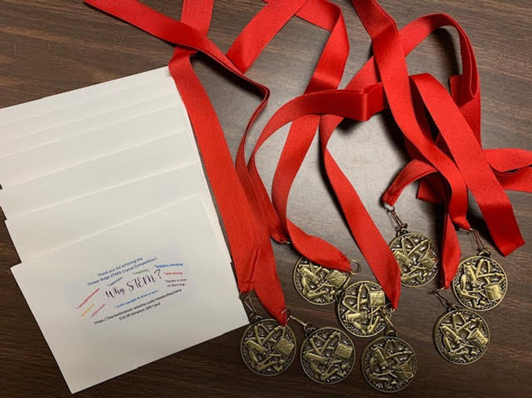 Last photo of medals and gift cards.jpg