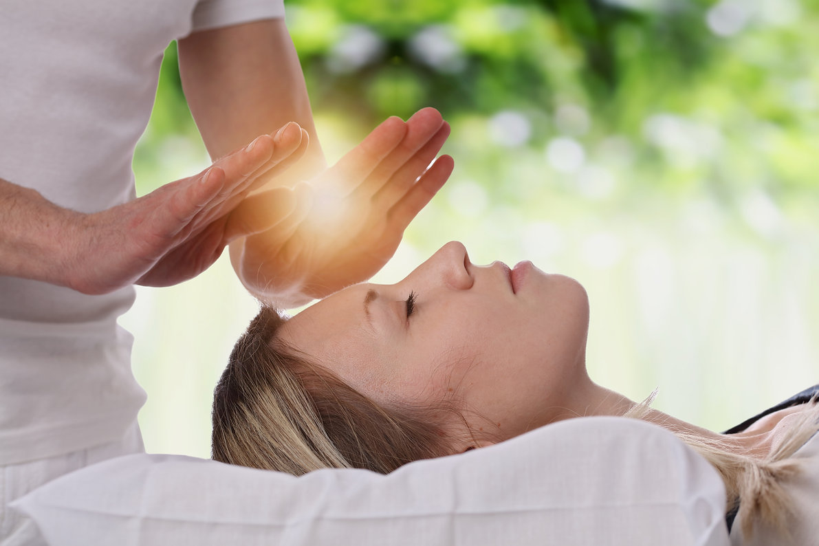 Woman having reiki healing treatment , a