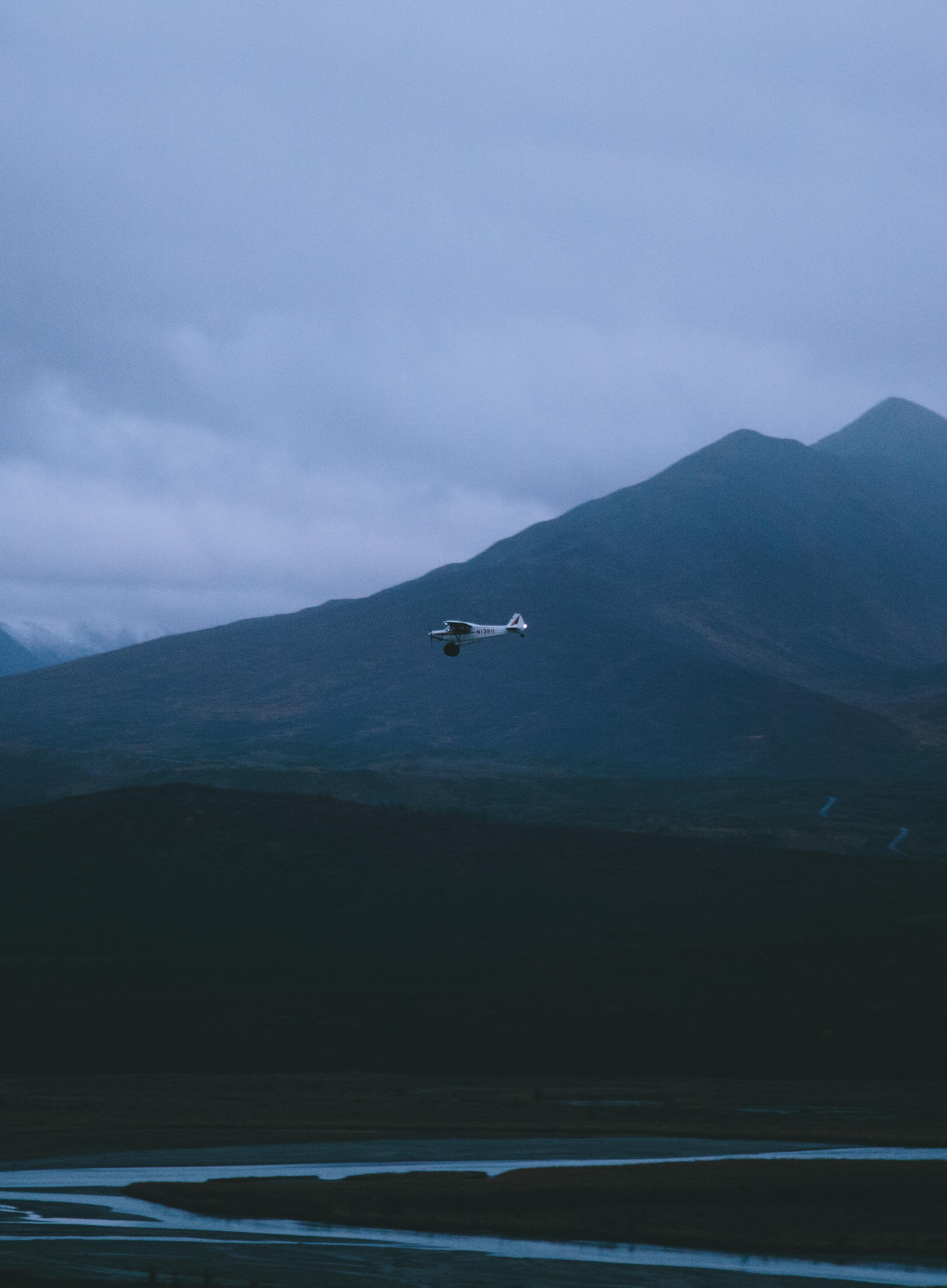 Piper Cub flying over Alaska Wild