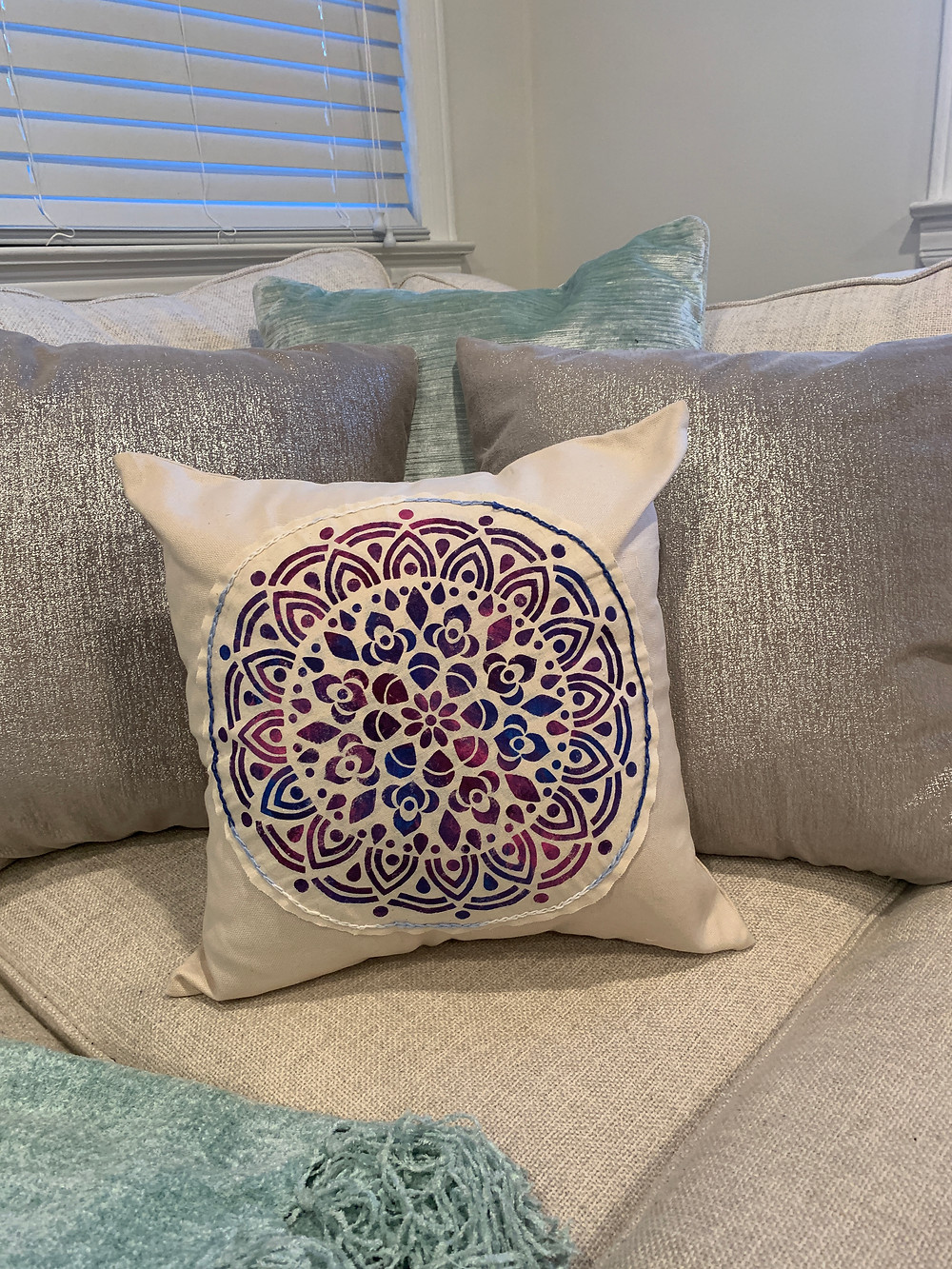 medallion stenciled and appliqued pillow