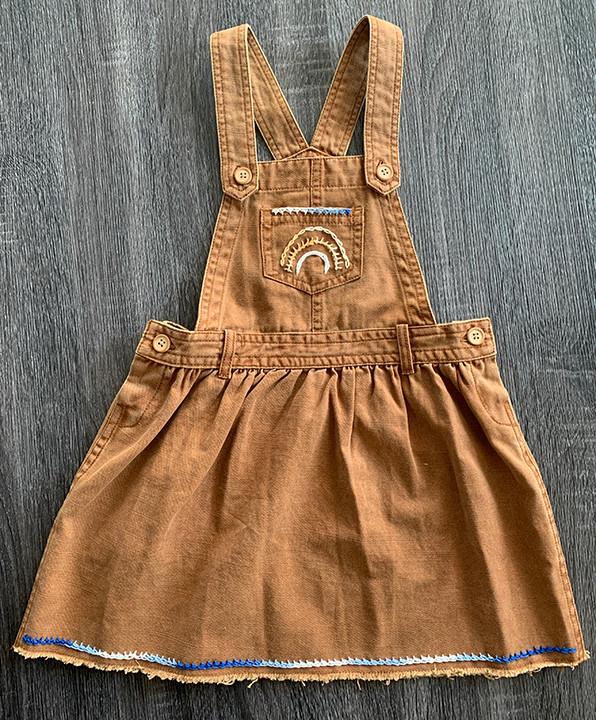 embroidered girls bib on skirt all