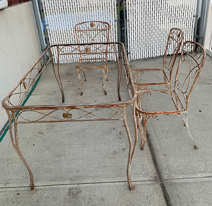 old rusted wrought iron patio set