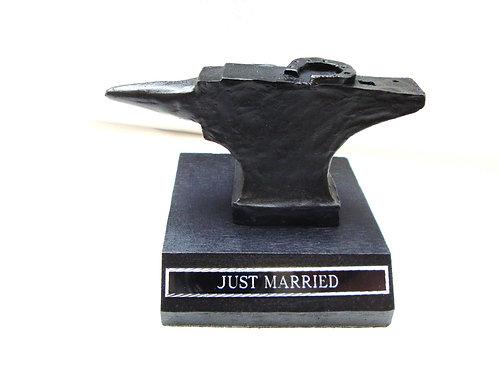 Anvil on a base engraved