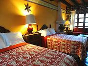 ROOM #4 JR SUITE 2 DOUBLE BEDS.JPG
