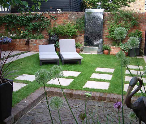 Water wall brick walling stepping stones. Mark Langford Garden Design Buckinghamshire