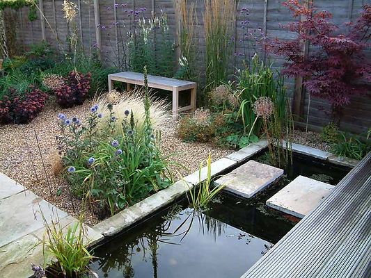 Stepping stones over water pool. Mark Langford Garden Design. Cambridgeshire