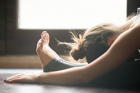 Young woman practicing yoga, sitting in