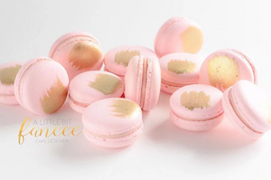 Strawberry and gold macarons
