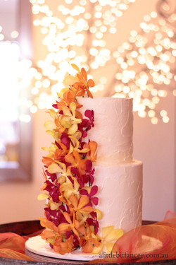 Fresh orchids and buttercream cake