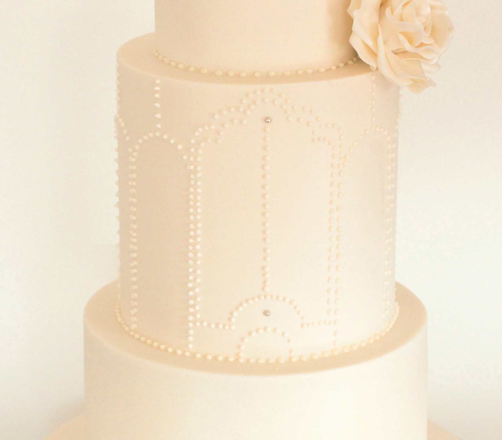 Tall and elegant, traditional ivory and hand piped royal icing designs.