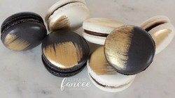 Black, white and gold macarons