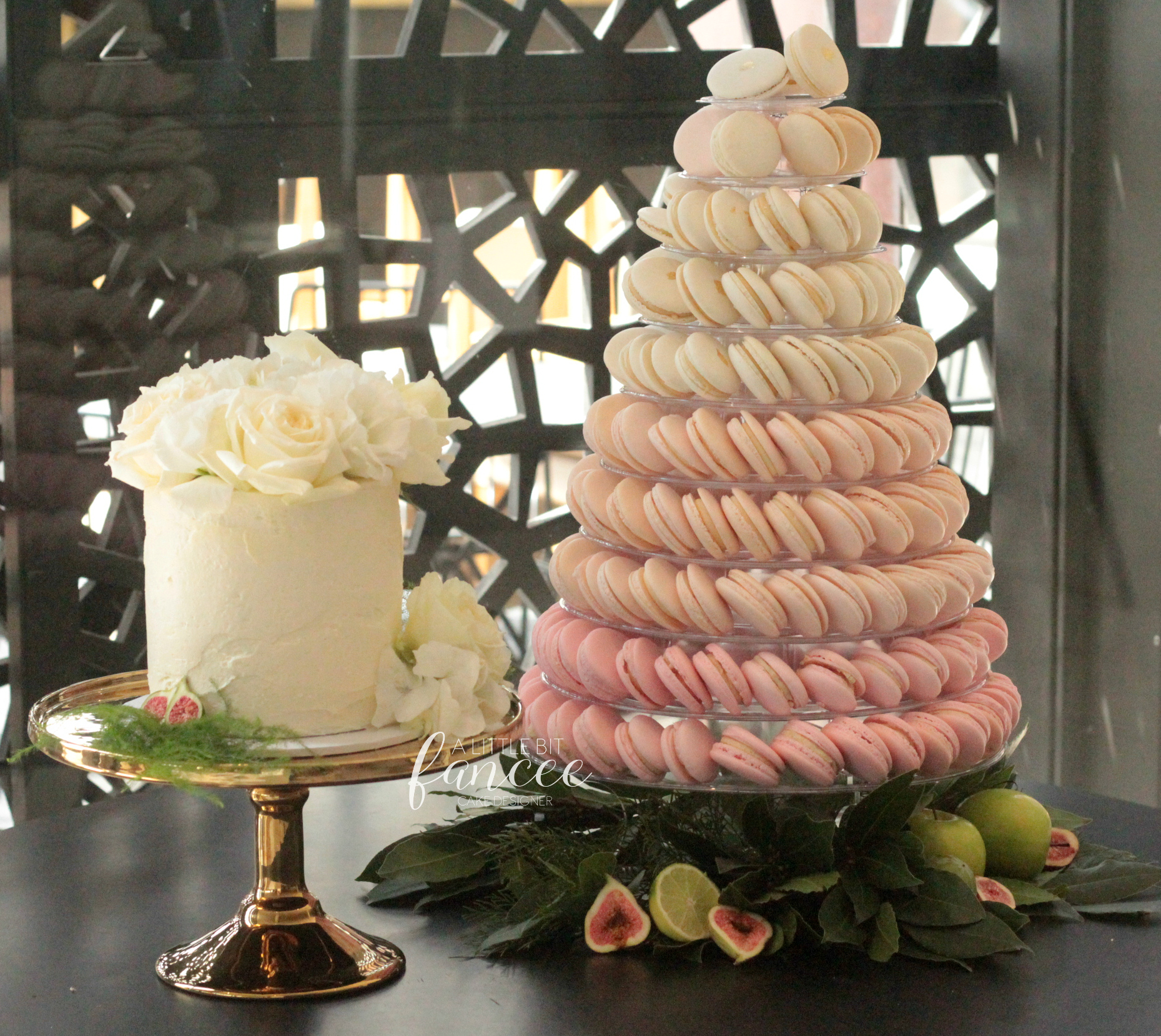 Cutting cake and macarons