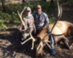 Trophy elk with outfitter Rob Degner and client.