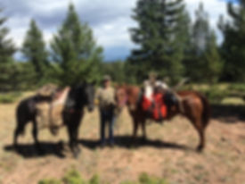 Rob Degner packing an elk out on the horses.