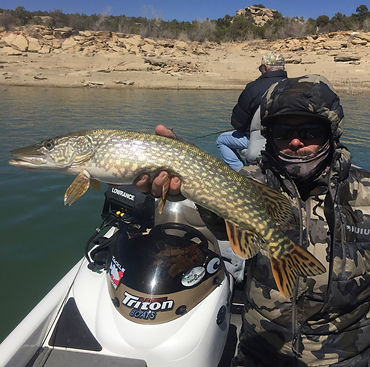 Royce Olney, fishing client with Northern Pike, Triton Boat