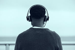 Man%20Listening%20to%20Headphones_edited