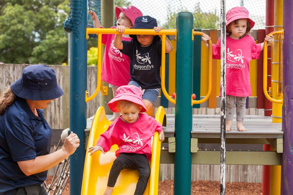 Kids at the playground with their teacher - Dragonfly's Childcare