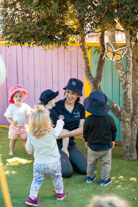 Childcare educator with her little students - Dragonfly's Early Learning