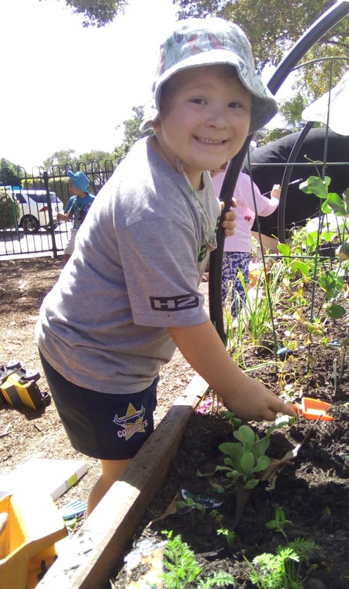 kid planting in a childcare centre