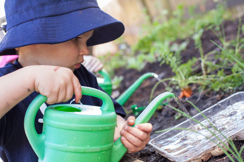 Kid watering the plants | Dragonfly's Early Learning