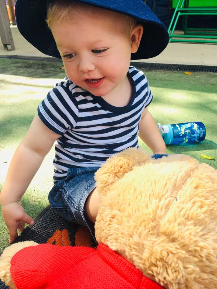 Dragonfly's Kids with a stuffed bear - Dragonfly's Early Learning Sunshine Coast