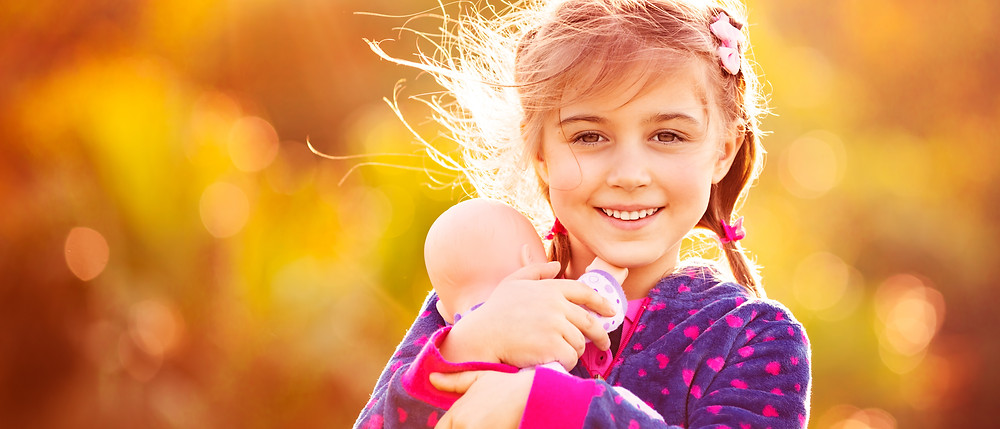 Girl holding her toy doll