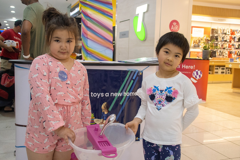 Two girls holding a shower toy