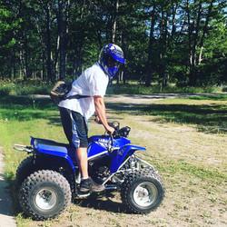 Gunner on his Yamaha Blaster four-wheeler
