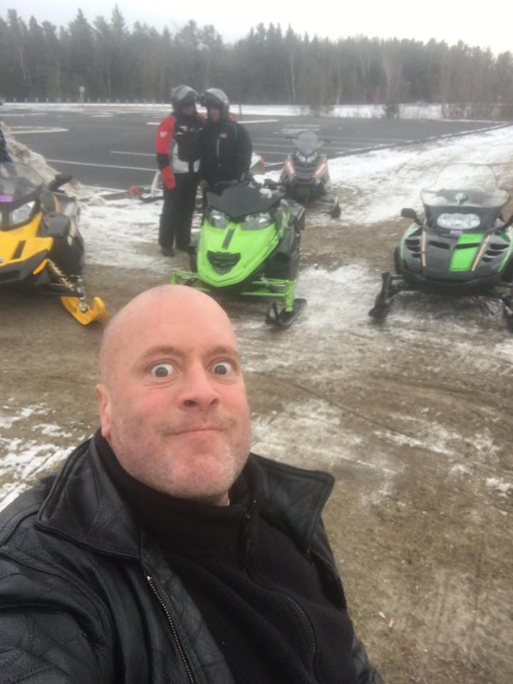 Gunner snowmobiling with friends