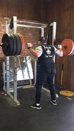 Gunner Squatting at the Gym