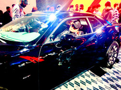 Gunner in a Shelby GT Mustang