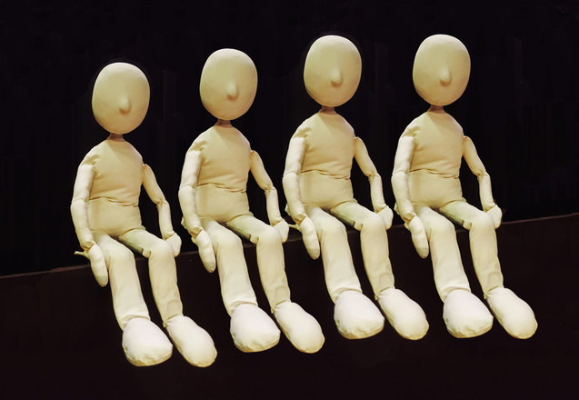Four small neutral puppets