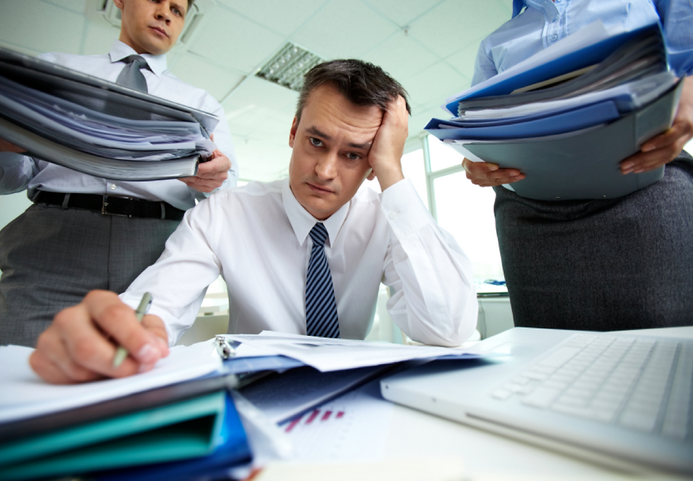 Image of overwhelmed project manager
