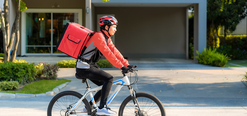 Asian man courier on bicycle delivering