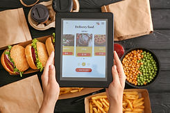 Woman with tablet computer ordering food