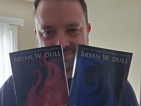 Me with the first two books I ever wrote...