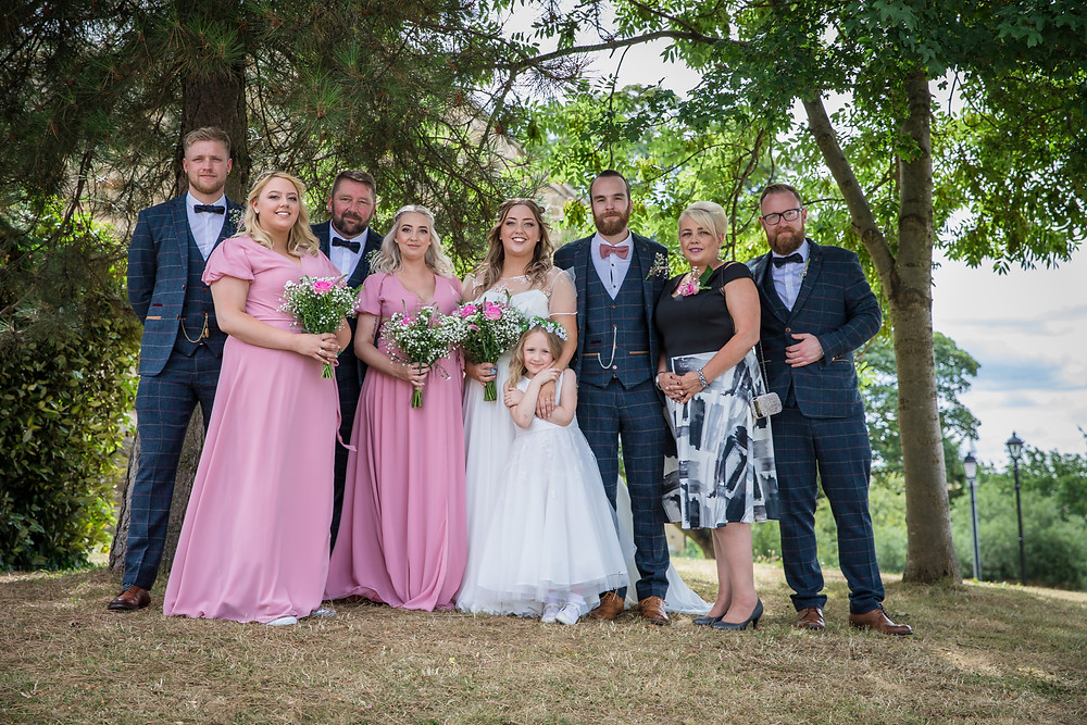 A group photo of the bride's family with the happy couple