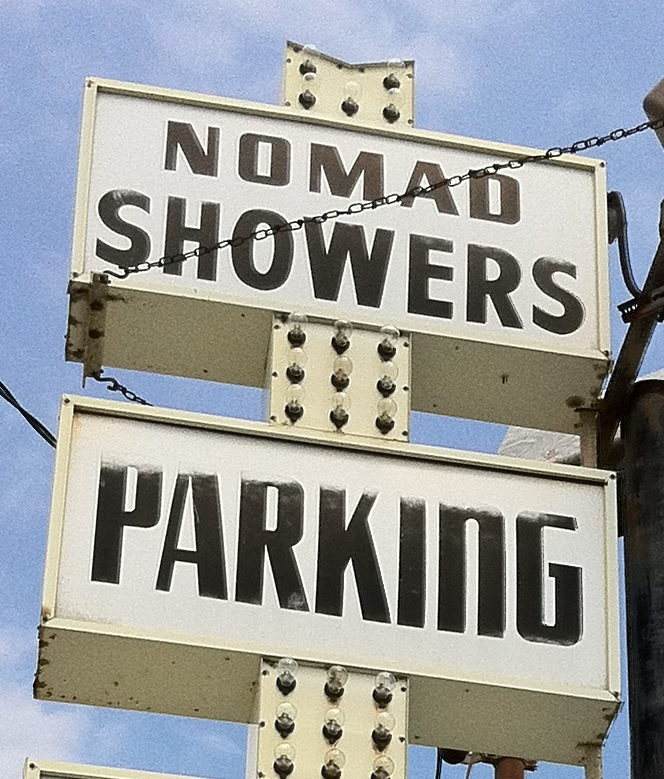 Nomad Showers Sign