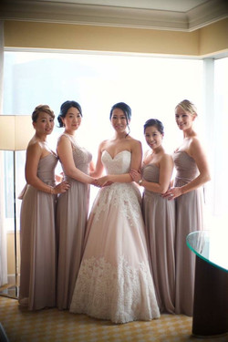Bridesmaids in custom gowns