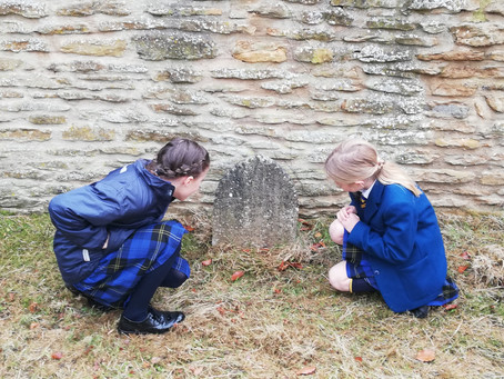 North Yorkshire students survey local graveyard.