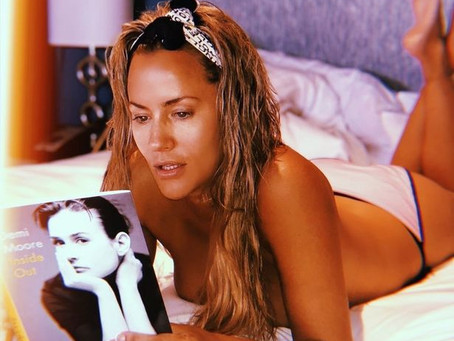 Caroline Flack goes topless