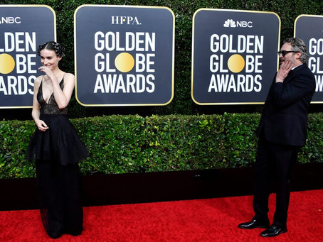 Golden Globe - Joaquin Phoenix stood away from his fiancee so he could admire her