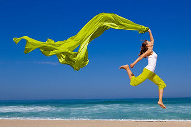 Woman jumping on a beautiful beach