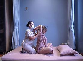 Massage therapist giving a customer a Thai massage