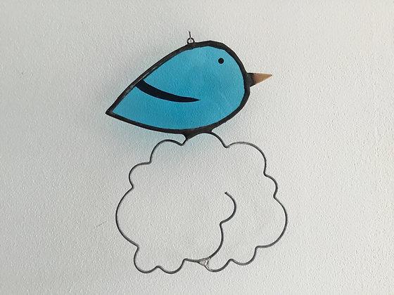 Mini oiseaux sur nuage bleu