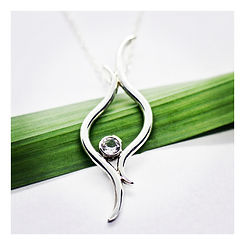 3. yourliri jewellery flame collection sleek silver flame pendant necklace with white topa
