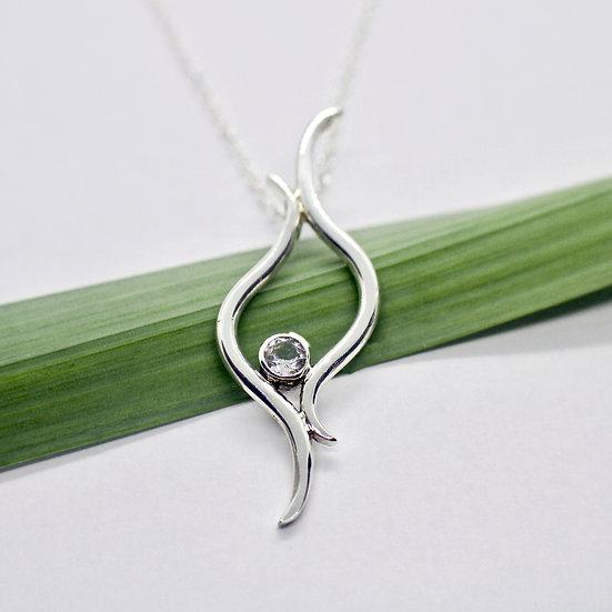 Elegant Silver Flame Pendant Necklace with White Topaz Gemstone